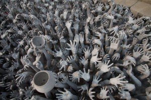 Hands reaching from the ground, at the White Temple