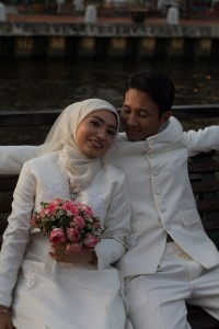 Newlyweds having pictures taken by the river in Malacca