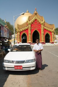 Our guide, his car, and the boob stupa.