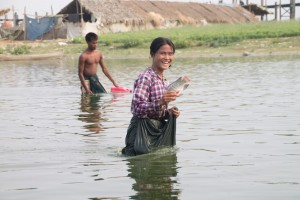 Happy with her catch. They store caught fish in a big fold of their skirts