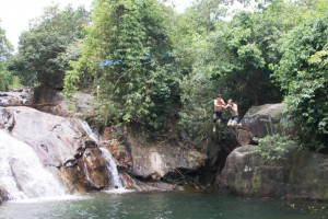 Jumping off a rock with my new friend