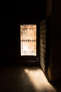 Sunlight through a door in Tarragona cathedral